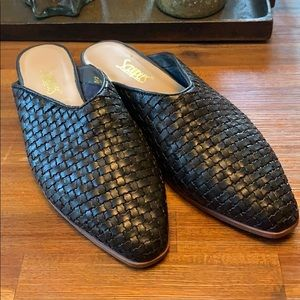 Woven leather mules.